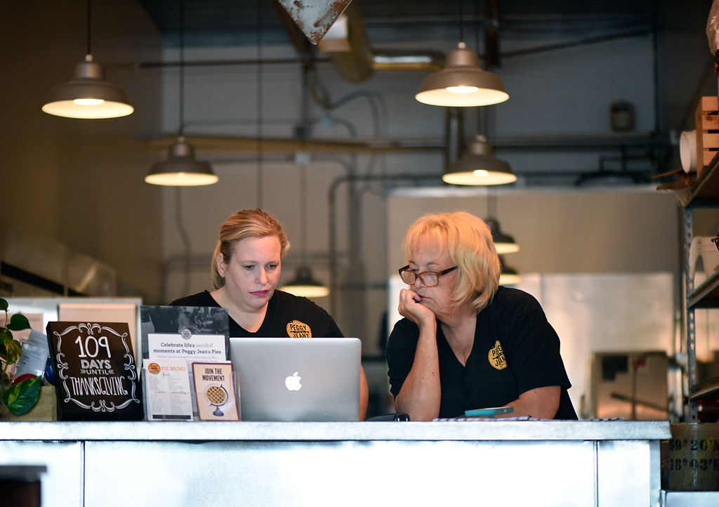 Co-owners Rebecca Miller and Jeanne Plumley make plans for the day's baking schedule
