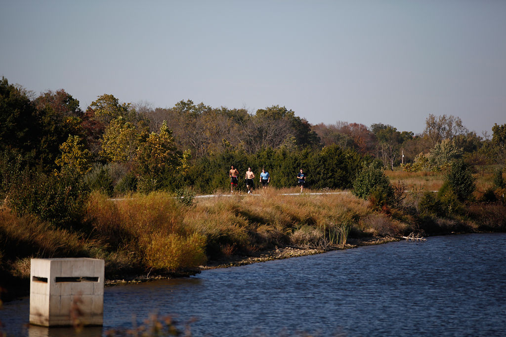 Members of Tolton Catholic High School's basketball team take a lap around the lake
