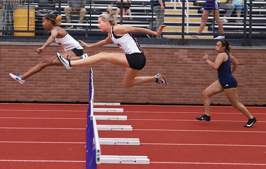Meaghan Hammonds and Riley Schonhardt  jump over hurdles