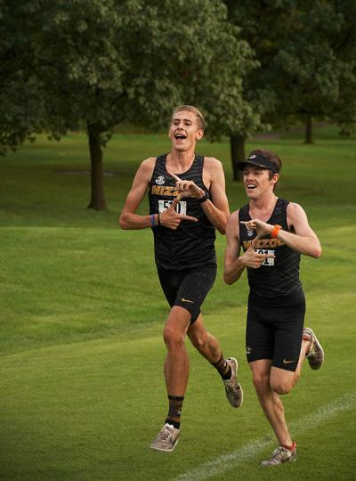 "Kieran Wood and Thomas George celebrate by showing a ""Z"" sign as they cross the finish line on Friday at L.A. Nickell Golf Course"