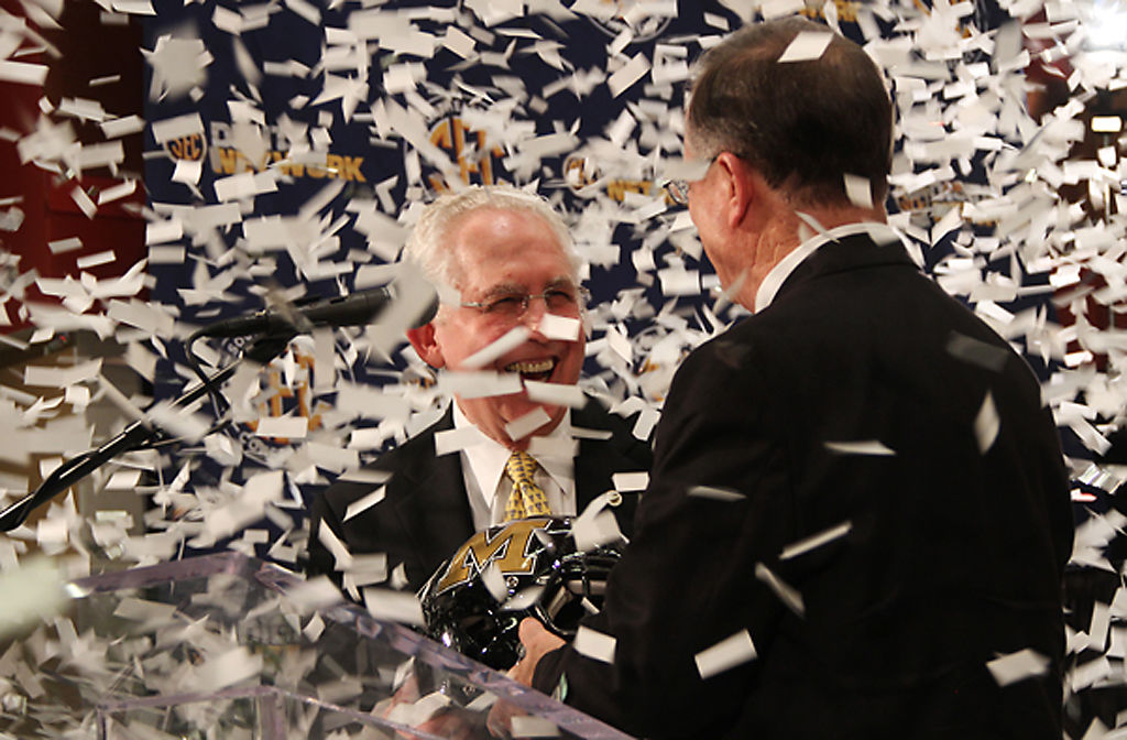 Southeastern Conference Commissioner Mike Slive and MU Chancellor Brady Deaton celebrate