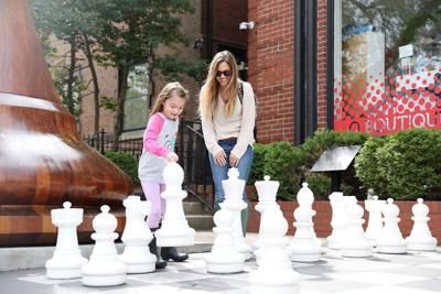 Kinley Boorn, left, and her mother Jessica Boorn play chess