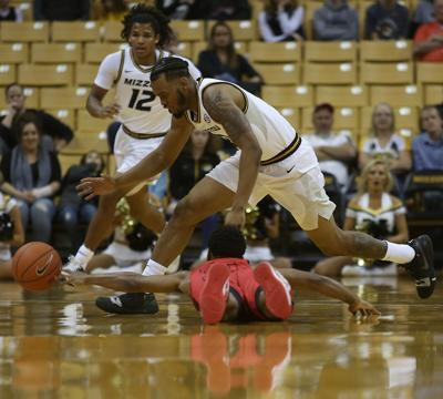 Missouri guard Torrence Watson goes for a loose ball as Central Missouri guard Deandre Sorrels falls during the MU basketball exhibition game against CMU