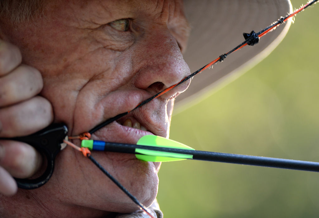 Dennis Dudley of Columbia draws his bow back