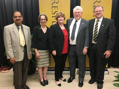 Sashi Satpathy, Patricia Okker, Catherine Boain, Ronald Boain and Alexander N. Cartwright stand for a photo