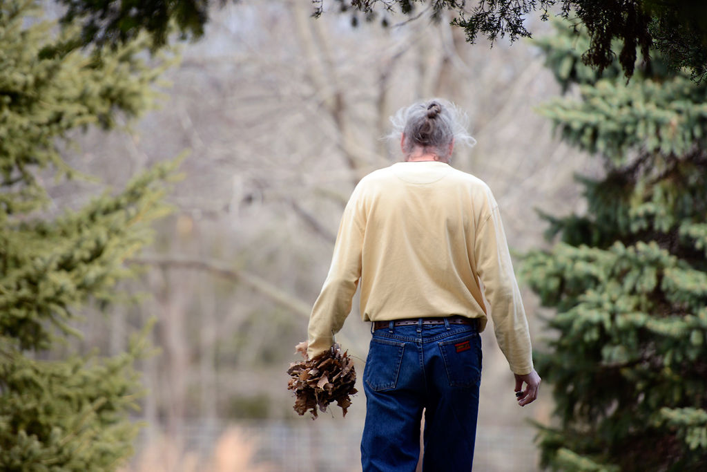 Brian Cottle carries leaves