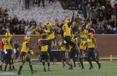 The Missouri defense celebrates a fourth down stop