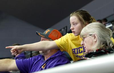 Ted Harrell, Belle Harell and Anna French watch the men's Missouri State High School 2019 Wrestling Championship