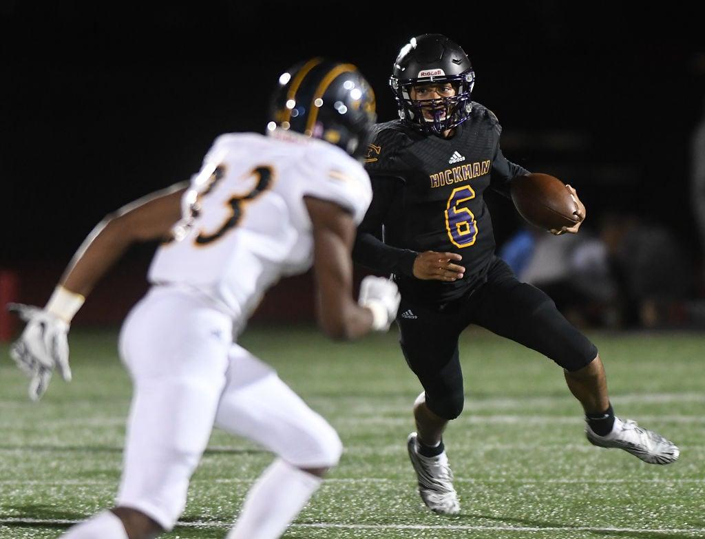 Hickman High School quarterback Jevean Brown attempts to evade Battle High School's Aaron Basden (copy)