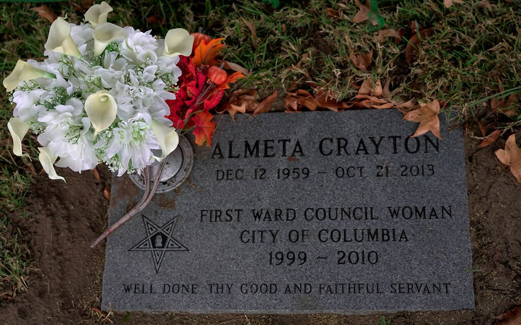The newly placed headstone of the late councilperson Almeta Crayton is complemented by some flowers