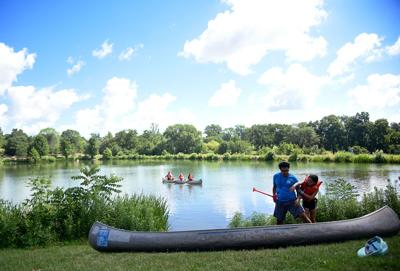 Counselors and campers prepare a canoe at Stephens Lake Park.