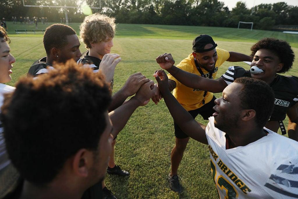 "Rock Bridge running back coach Kody Walker yells ""break!"""