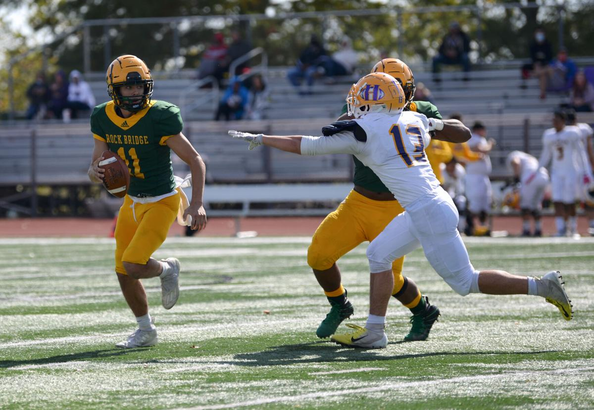Rock Bridge junior quarterback Nathan Dent runs with the ball