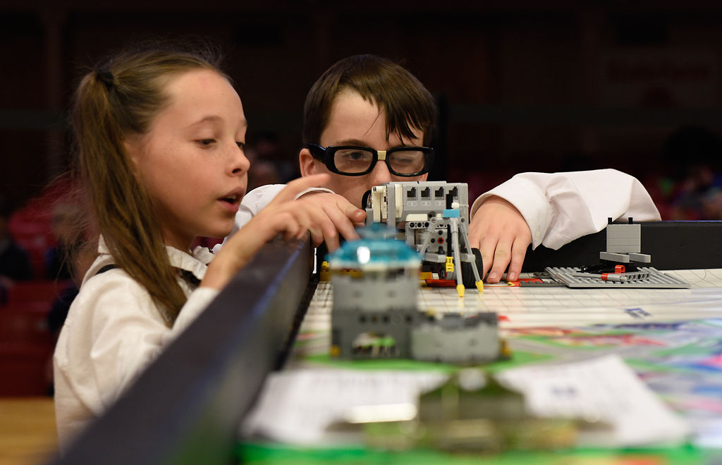 Emma Powell and Maxwell Spriggs check their robot before competing