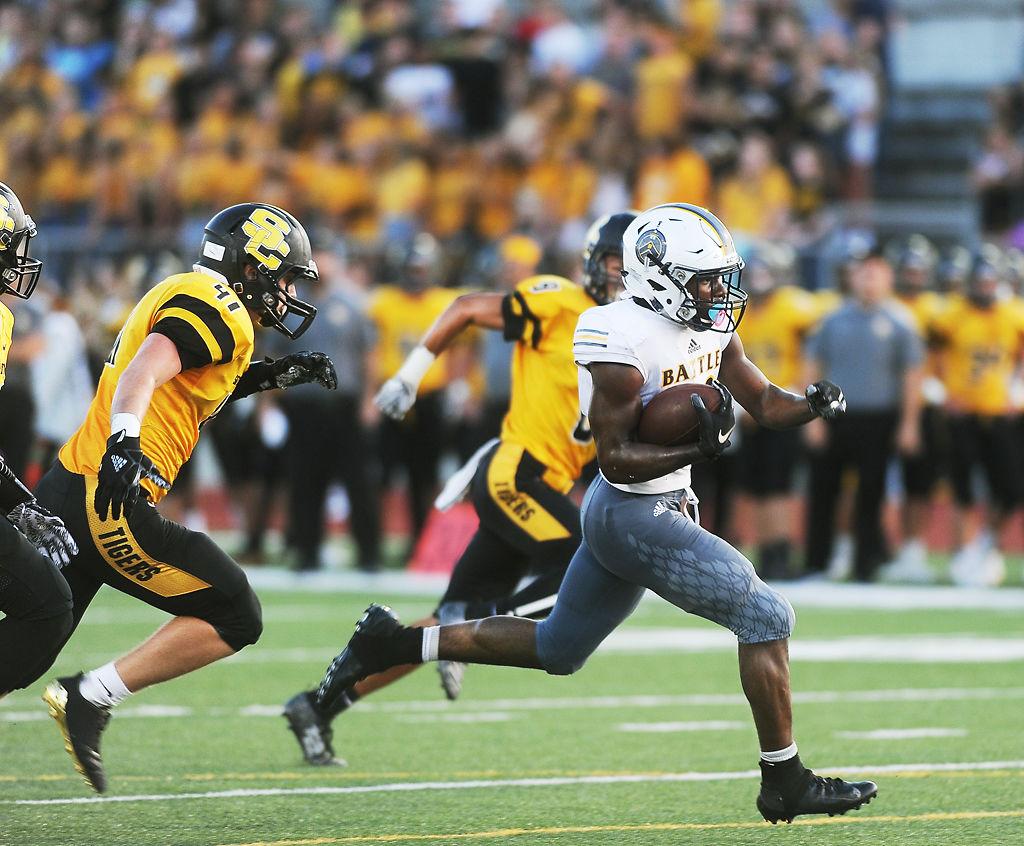 Battle High School running back Gerry Marteen runs in the team's second touchdown