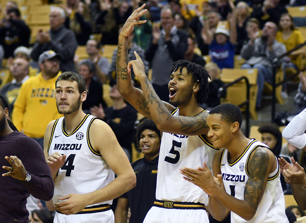 Reed Nikko, Mitchell Smith, and Xavier Pinson celebrate an offensive foul