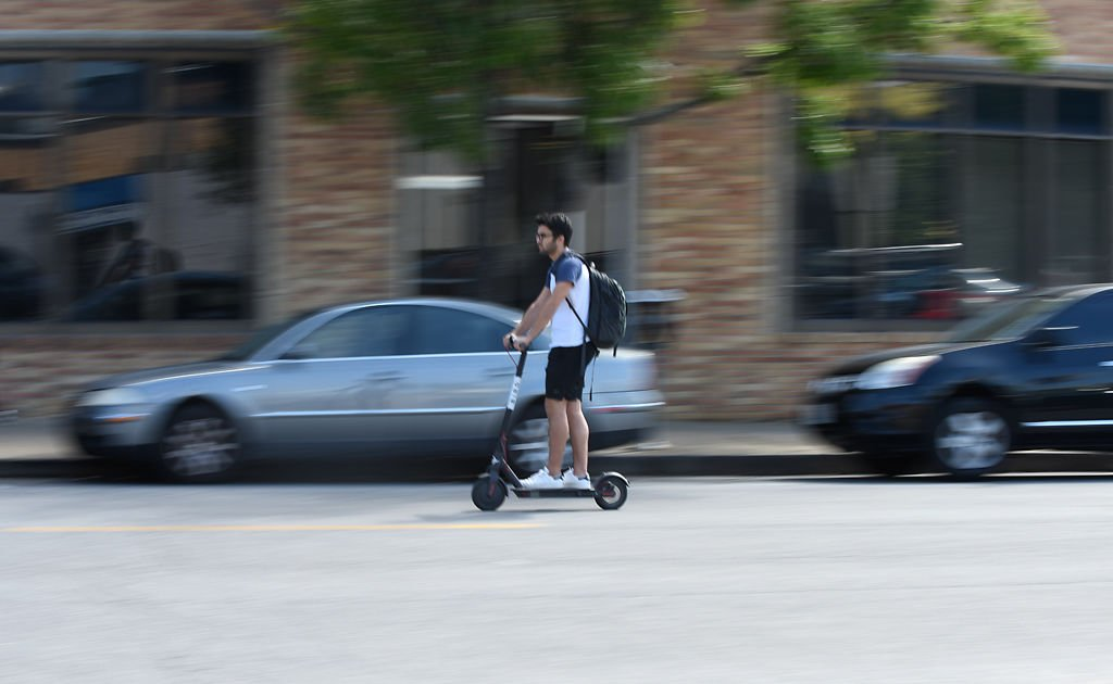 Jack Bizar goes to Lucky's Market on a Bird scooter