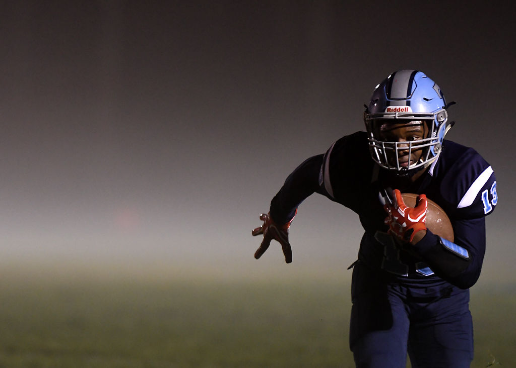 CJ Campbell, a wide receiver for Fr. Tolton Regional Catholic High School, sprints downfield