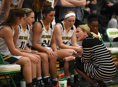 Rock Bridge High School basketball head coach Jill Nagel talks to her team