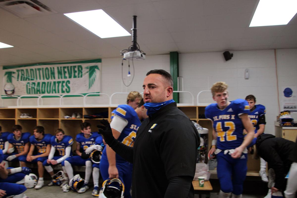 St. Pius X High School head coach Anthony Simone talks to his players