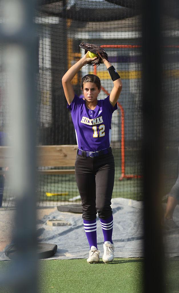 Abby Hurtado warms up before the softball game between Hickman Kewpies