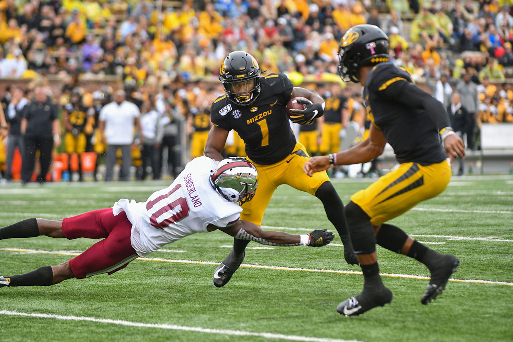 Missouri RB Tyler Badie leaps to evade the tackle