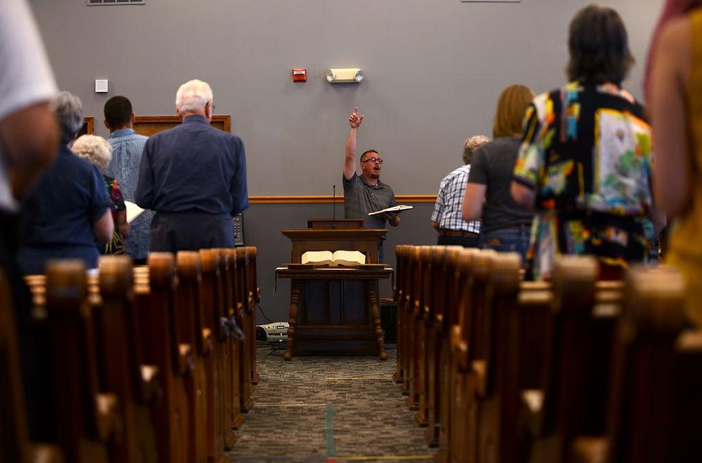 Choir member John Gray sings a Baptist Hymn at Grandview Baptist Church on its 150th anniversary service
