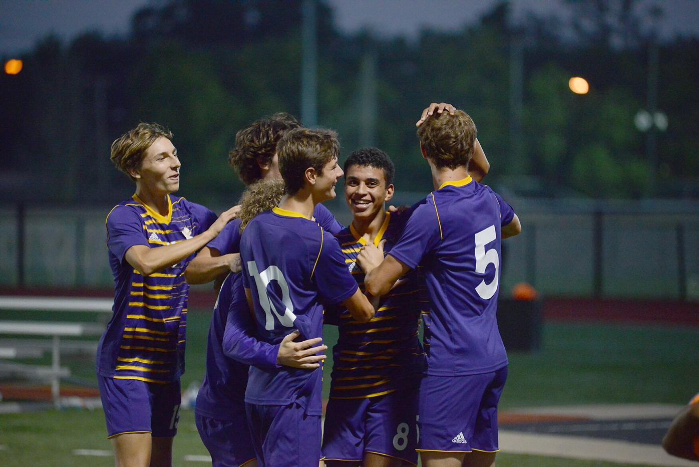 Hickman celebrates the final goal in the boys varsity soccer