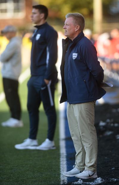 John Klein watches as the men's soccer team faces Lyon College