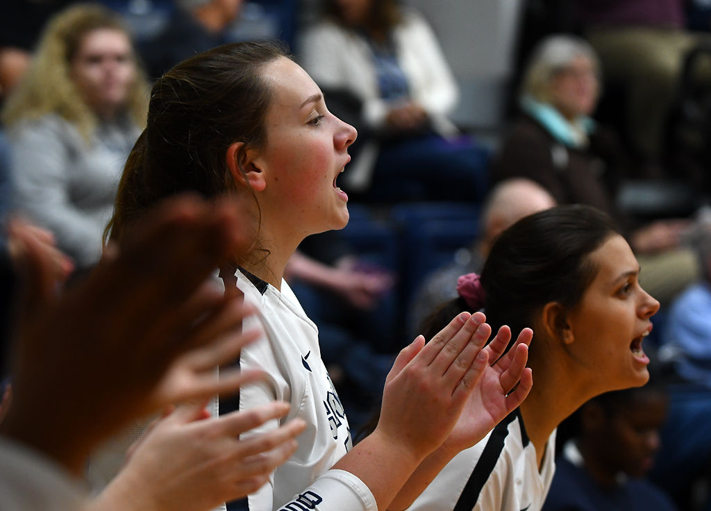 Columbia College volleyball players Camryn Schear and Raven Buckley cheer for their team