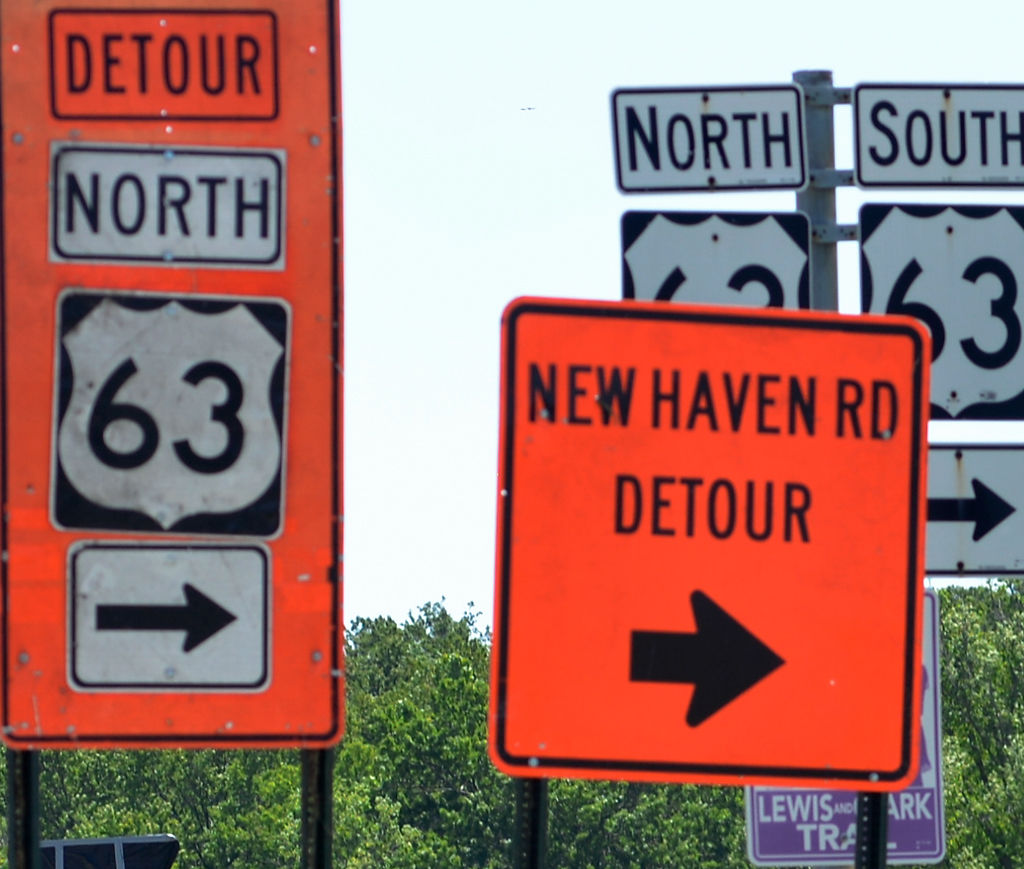 Signs describe the detour along U.S. 63 while Grindstone bridge remains closed