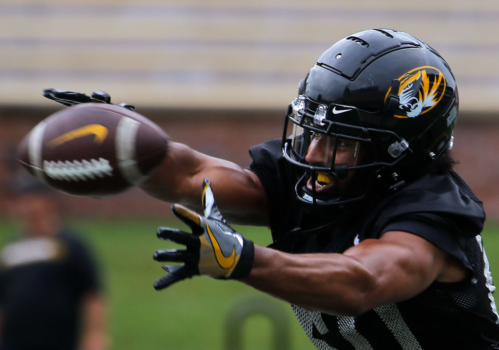 Missouri defensive back Khalil Oliver stretches to make a catch during a drill