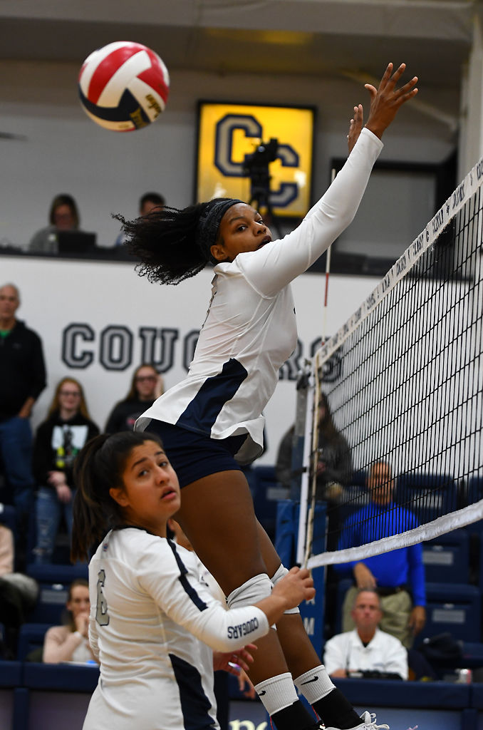 Columbia College player Aaliyah Durant jumps to block a hit