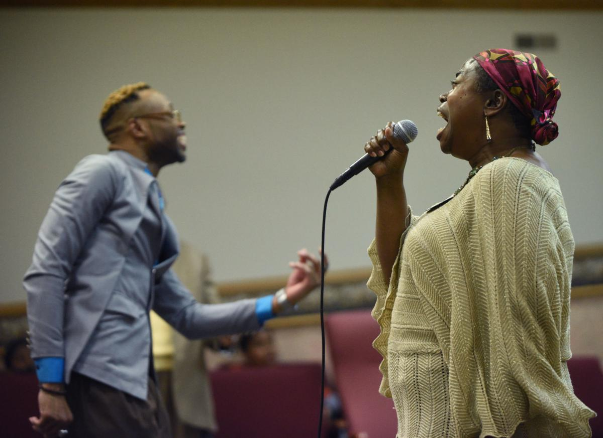Assistant Pastor Lamont Walker, left, and his mother, Renee Lewis, sing