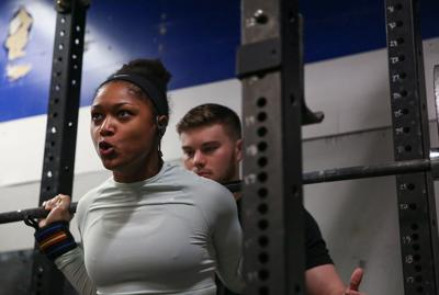 Two-time world record-setting powerlifter balances academics