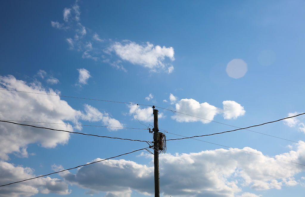 A series of power lines connect to a single pole