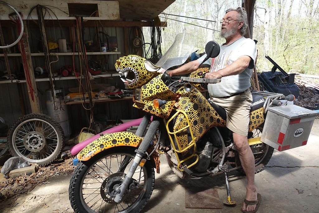 Tom Rote sits on his distinctive Jaguar motorcycle