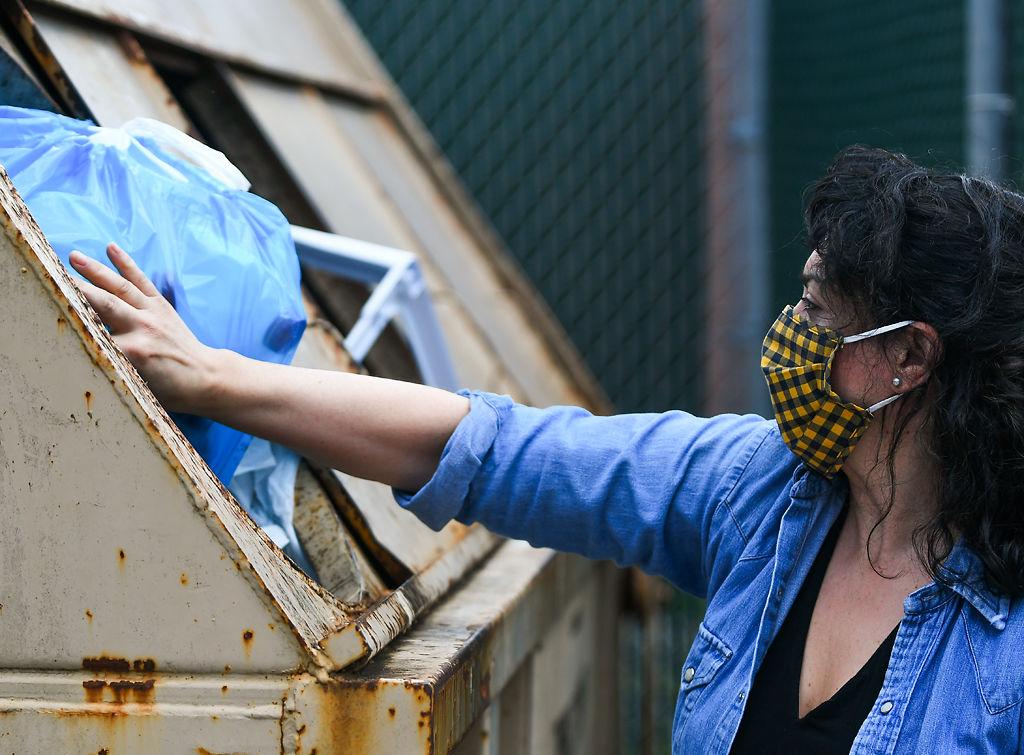 Rachel Harper disposes of recycling bags