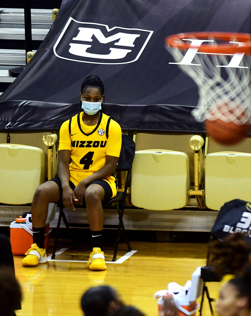 MU freshman Mama Dembele watches from the sidelines as the Aggies score
