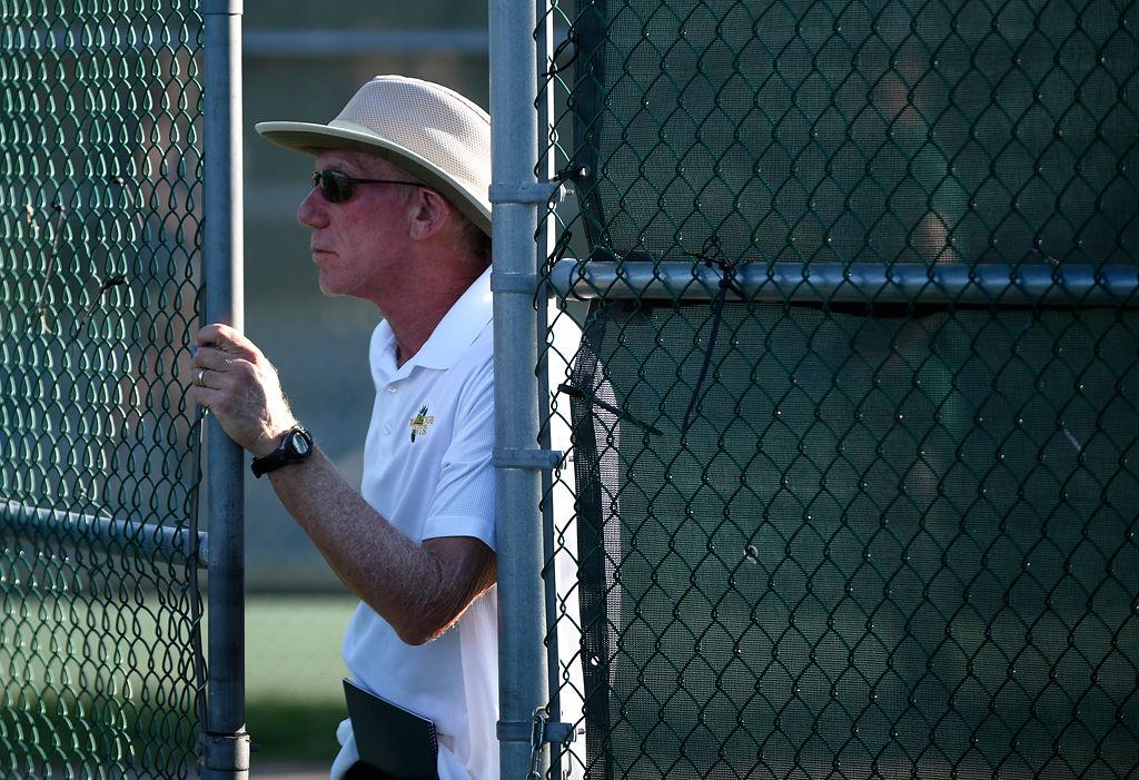 Head Rock Bridge tennis coach Ben Loeb watches as his team