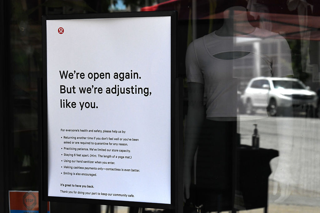 A sign details safety precautions for COVID-19 on Friday, July 10, 2020, at lululemon in downtown Columbia