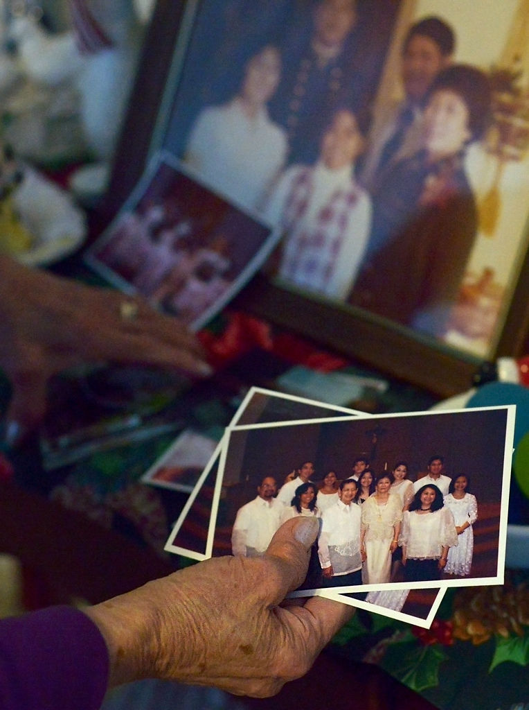 Alicia Molina looks through family photos