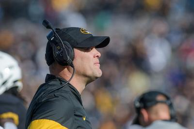 Missouri head coach Barry Odom looks to the field