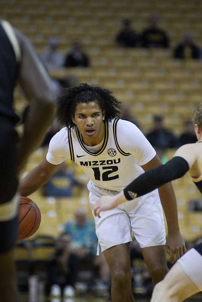 Mizzou player Dru Smith drives the ball down the court during the game against Wofford