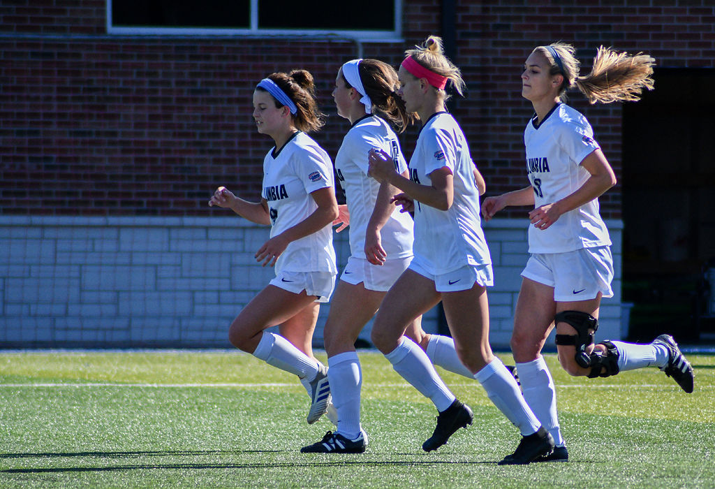 Columbia College's (From left) Brooke Schneider, Lucy Kingsley, Jewel Morelan, and Kelsey Mirts run towards the filed