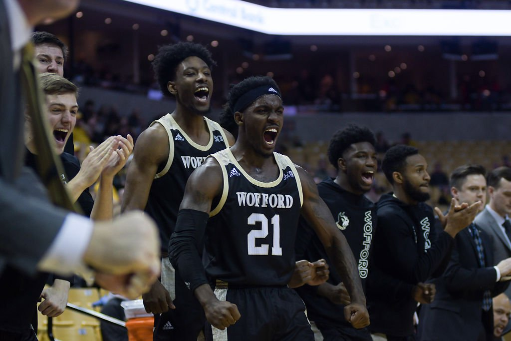 Wofford player Tray Hollowell cheers for his team after they scored a point against the Mizzou basketball team