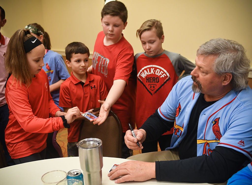 Former Cardinal pitcher Danny Cox signs baseball cards