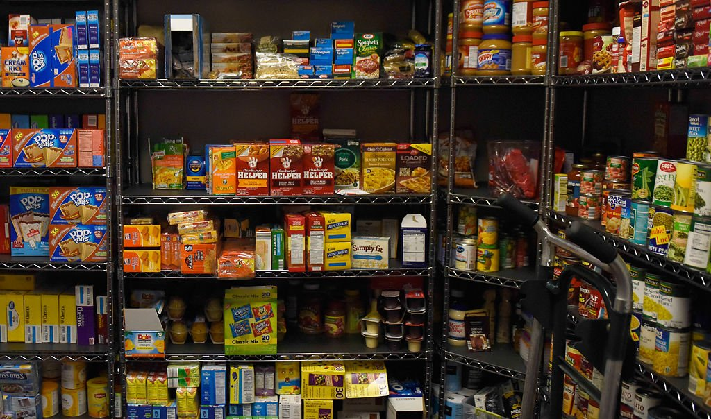 Canned and boxed food sit on shelves