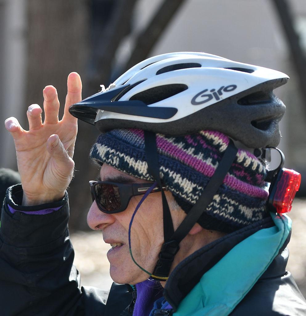 Mark Haim adjusts his helmet before embarking on the Katy Trail
