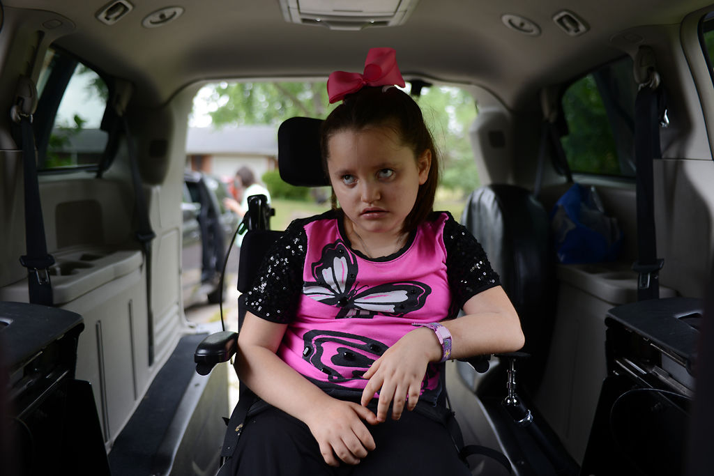 Maria Thomas waits in the car while her mother